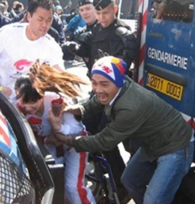 Chinese Attacks Wheelchair Torch Bearer