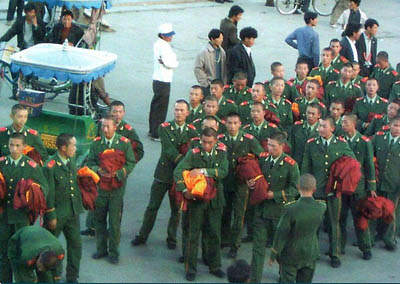 Chinese soldiers holding fake Tibetan monks' robes
