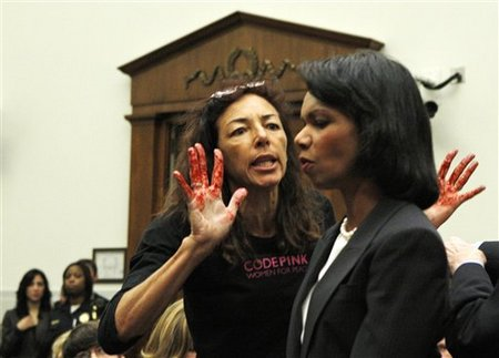 Code Pink protester with 'bloody' hands